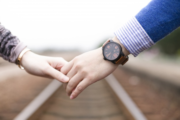 close-up-of-couple-holding-hands_1205-283.jpg